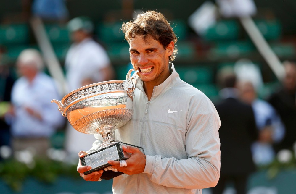 Rafael Nadal of Spain poses with the trophy during the ceremony after defeating Novak Djokovic of Serbia during their men's singles final match to win the French Open Tennis tournament in Paris